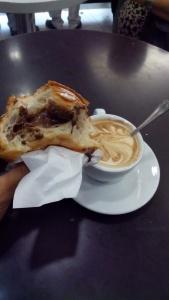 Sarapan pertama saya di Italia, segelas cappucinno dan sebuah cornetto coklat.