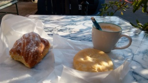 Early breakfast with cappuccino,cornetto and focacia